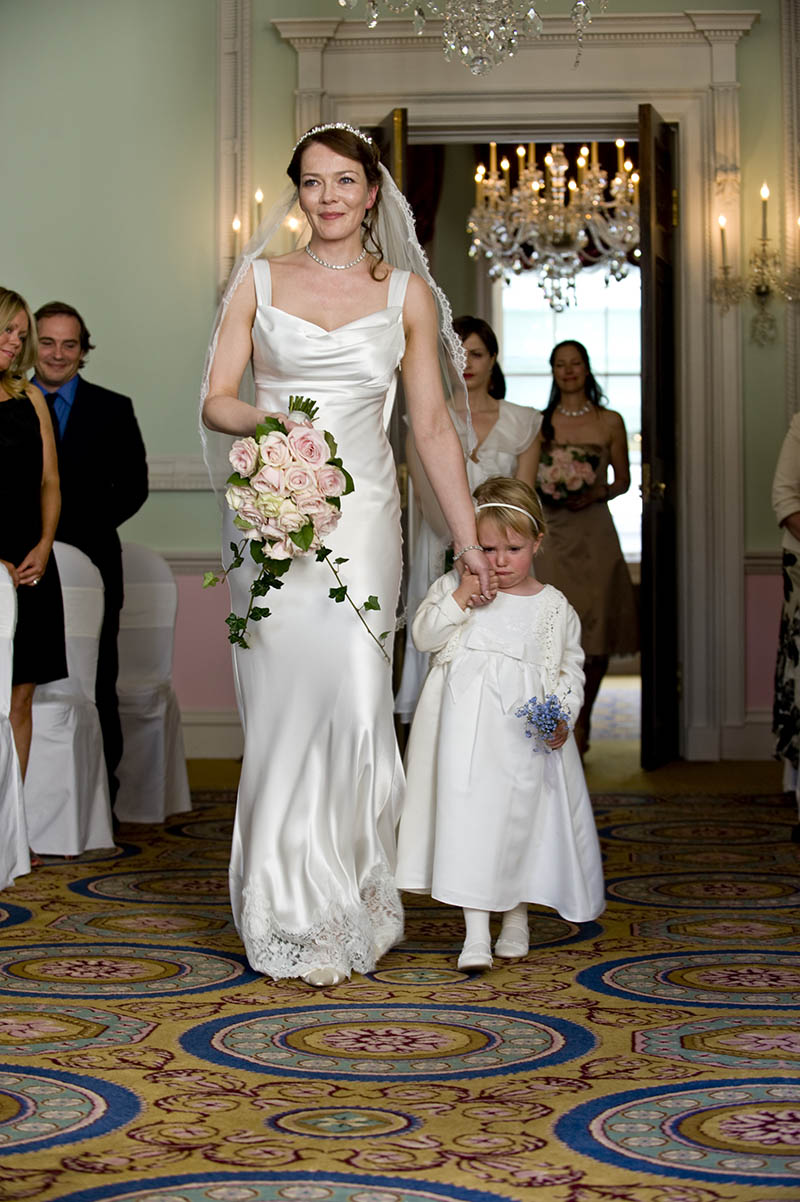 bride walks down the aisle at chandos house wedding