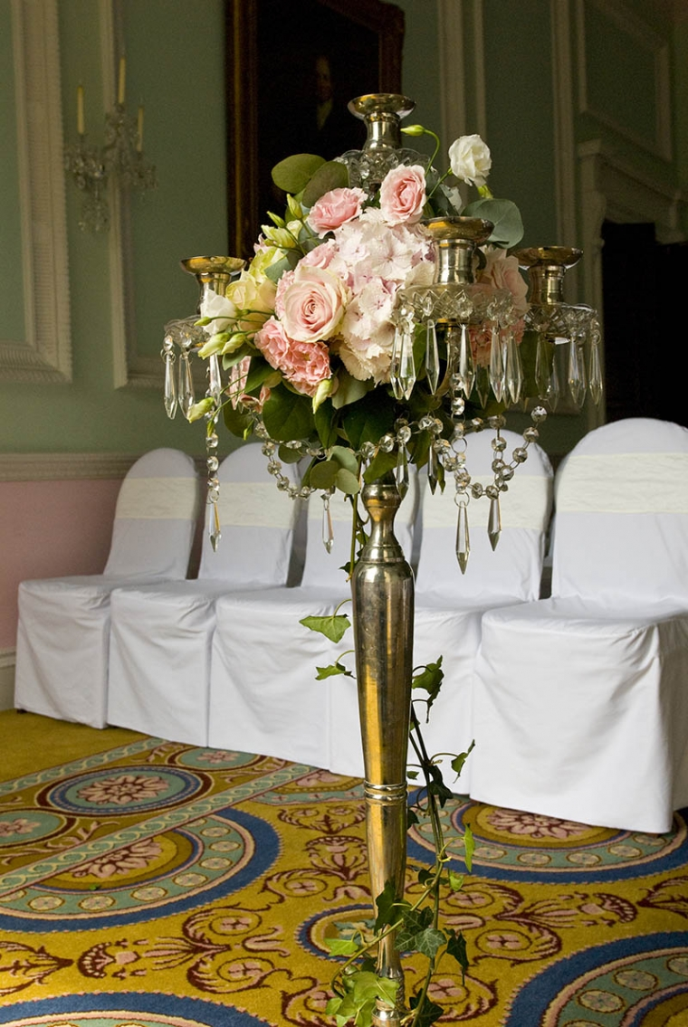 candelarbra with bridal flowers at chandos house wedding