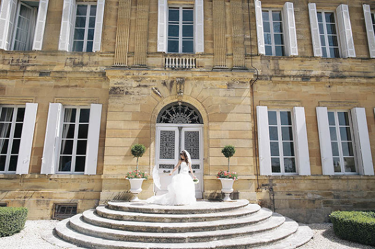 bride her with parasol in french destination wedding