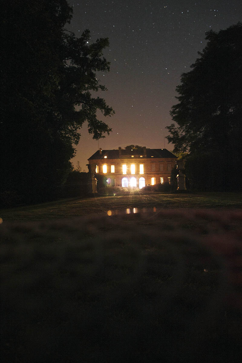 night photo of chateau la durantie with stars