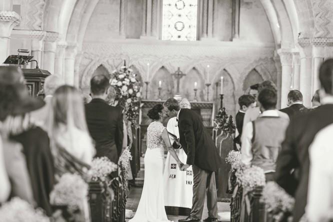 wedding kiss at the church altar