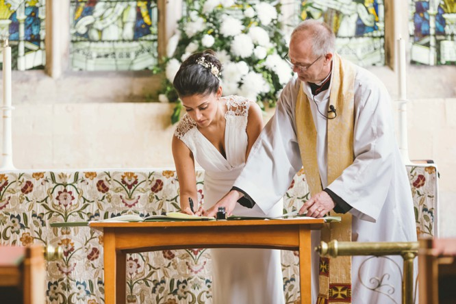 bride wearing justin alexander wedding dress