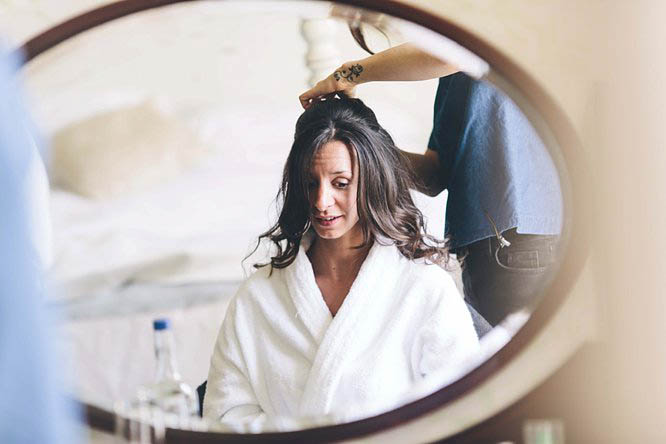 bride getting ready before her wedding in cotswolds