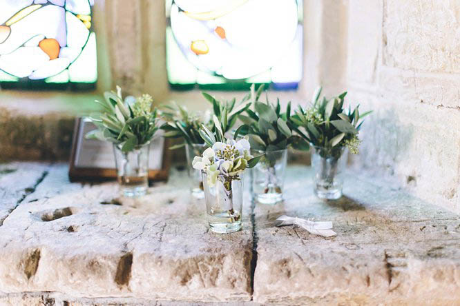 miniature glasses with wedding flowers