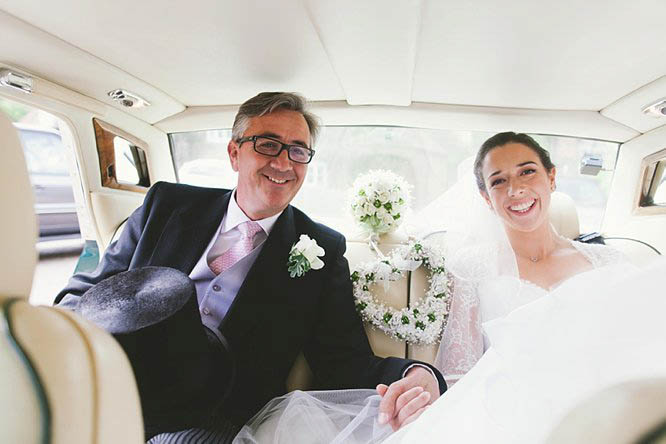 bride and her father in rolls royce wedding car