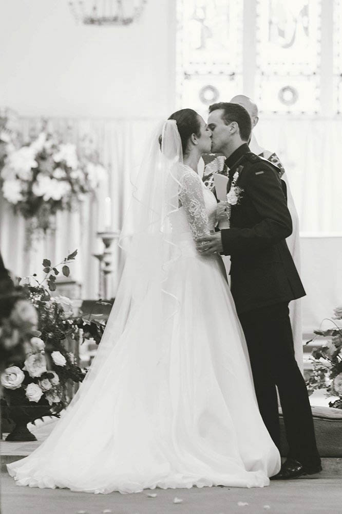 bride and groom black and white kiss