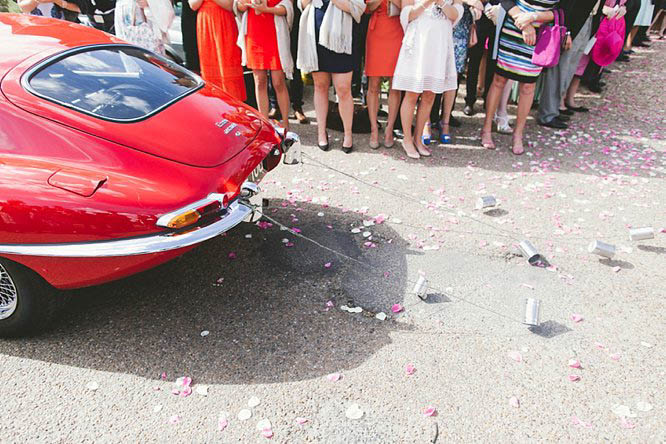 wedding car with tin cans at the back