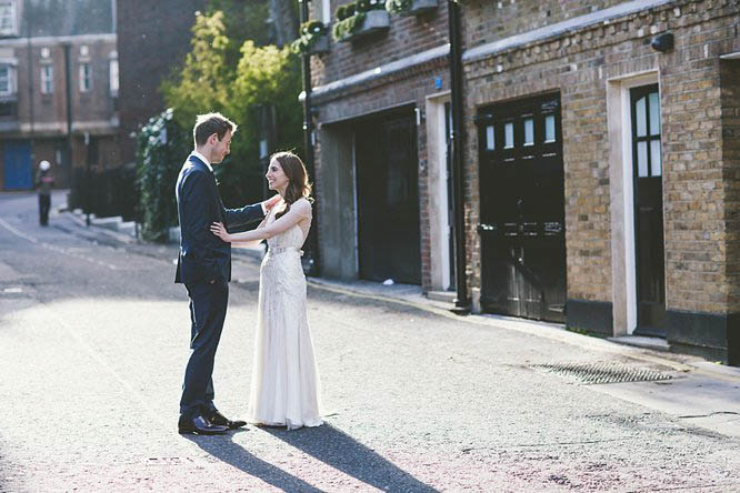 bride and groom hold hands after their mayfair wedding