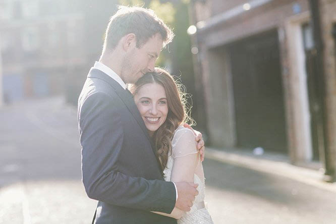 married couple hug in mayfair street