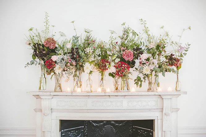 vintage wedding florals above mantelpiece at one horse guards