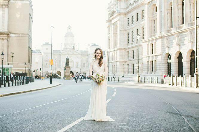 bride wearing temperley full length wedding dress