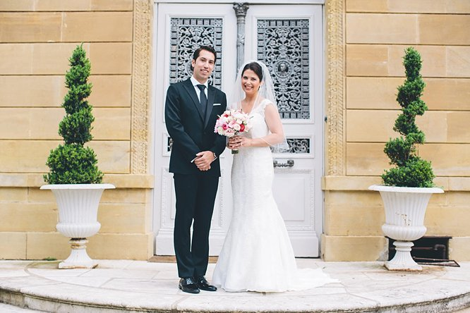 traditional photo bride groom on steps of french chateau