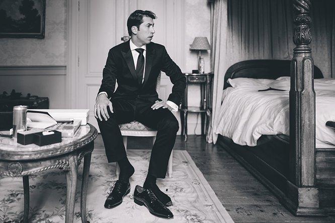 black and white photo groom black tie