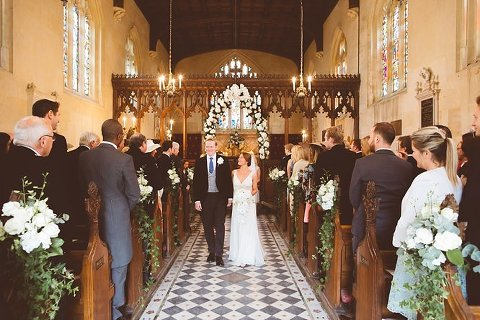 bride and groom walk down aisle sudeley castle