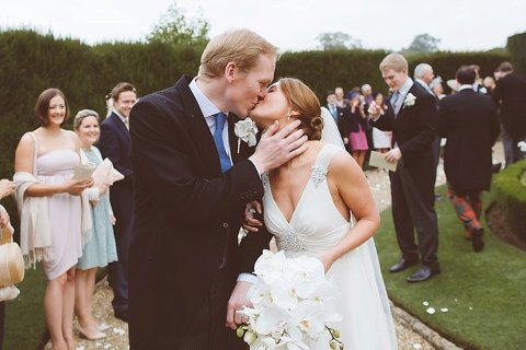 bride and groom kiss at wedding sudeley castle