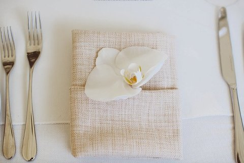 orchid place setting wedding