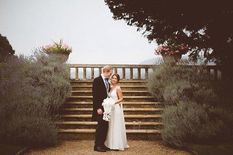 bride wearing jenny packham ivory full length silk dress