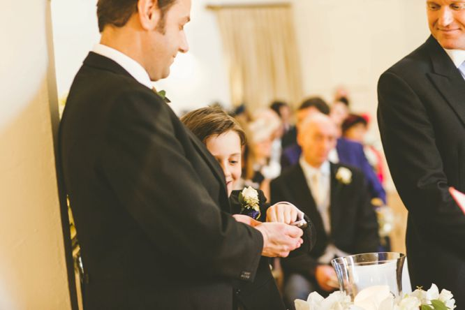 best man with rings at wedding farnham castle