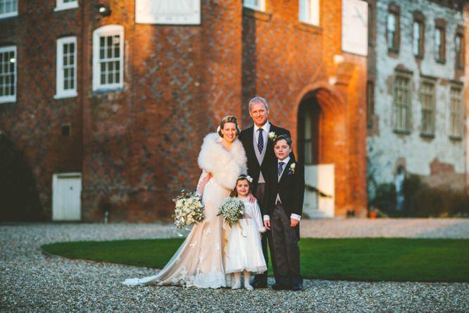 farnham castle winter wedding group formal photo