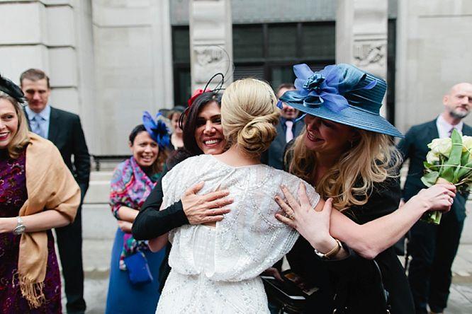 emotional guests hug bride at rsa house wedding