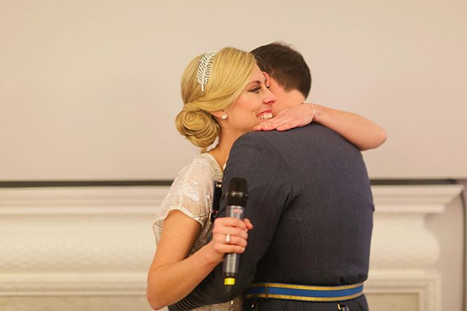 bride hugs groom during speeches