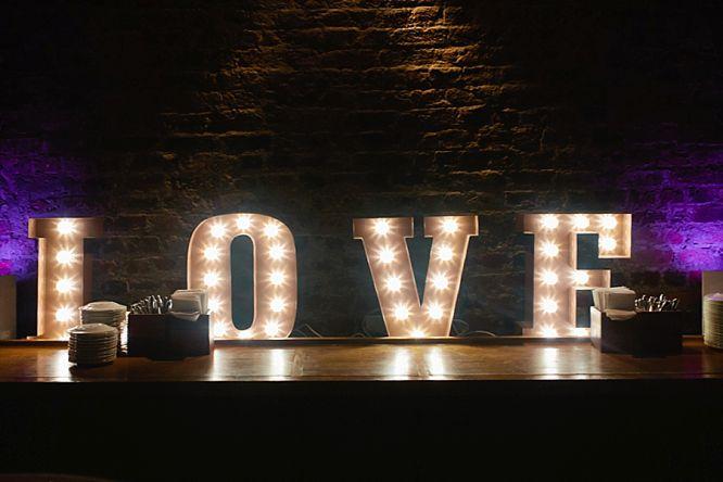 love wedding sign lit up dance floor