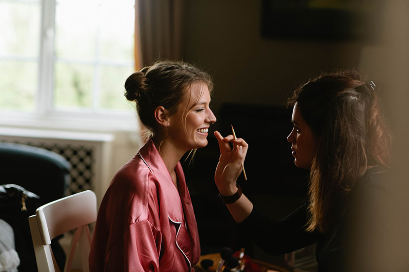 bridesmaid having make up applied